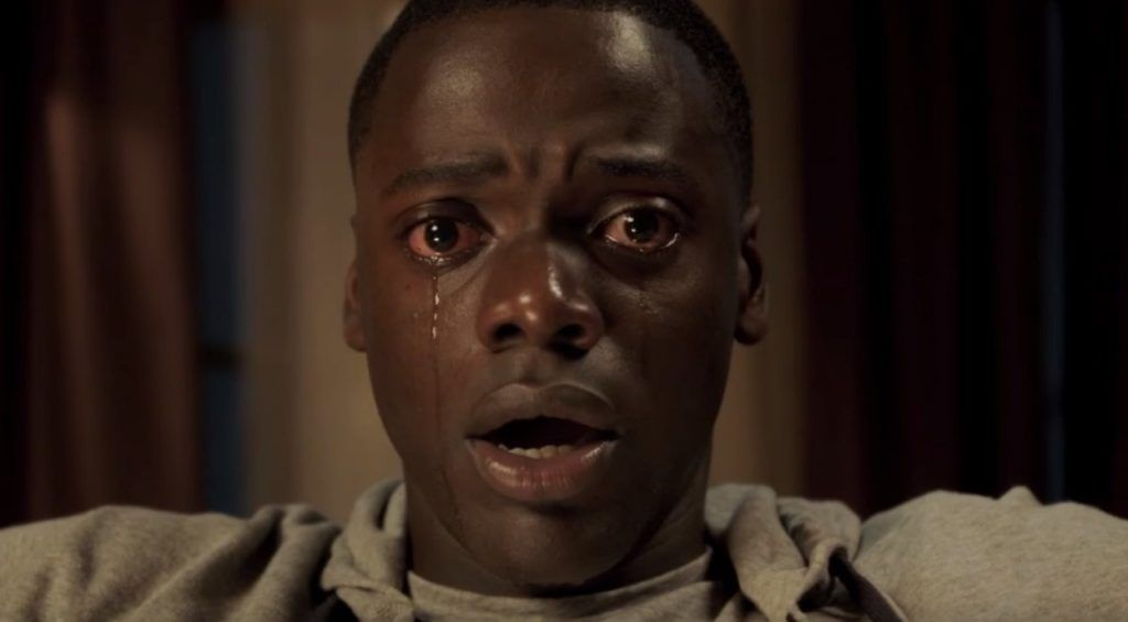 Daniel Kaluuya as Chris Washington staring straight into the camera, crying in 'Get Out'