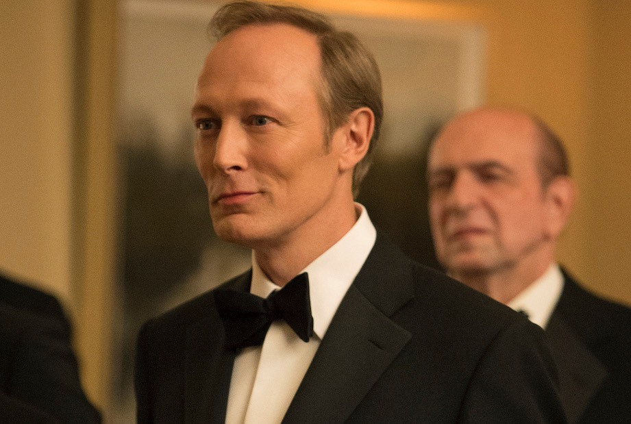 Lars Mikkelsen wearing a tuxedo, smiling, and looking to the left of the frame