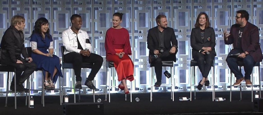 The cast of Star Wars: The Last Jedi, sitting on stools at a Celebration panel