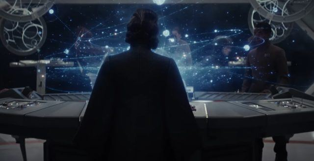 Leia looking at a holographic star charts.