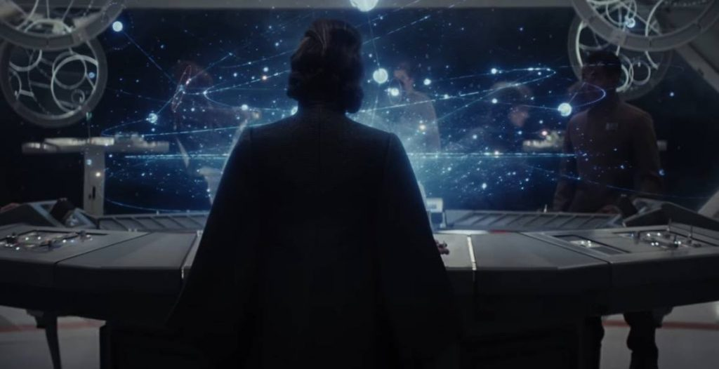 Leia looking at a holographic star charts