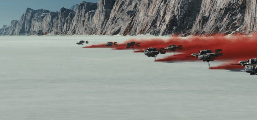 Speeders trailing red smoke across a salt flat in Star Wars: The Last Jedi