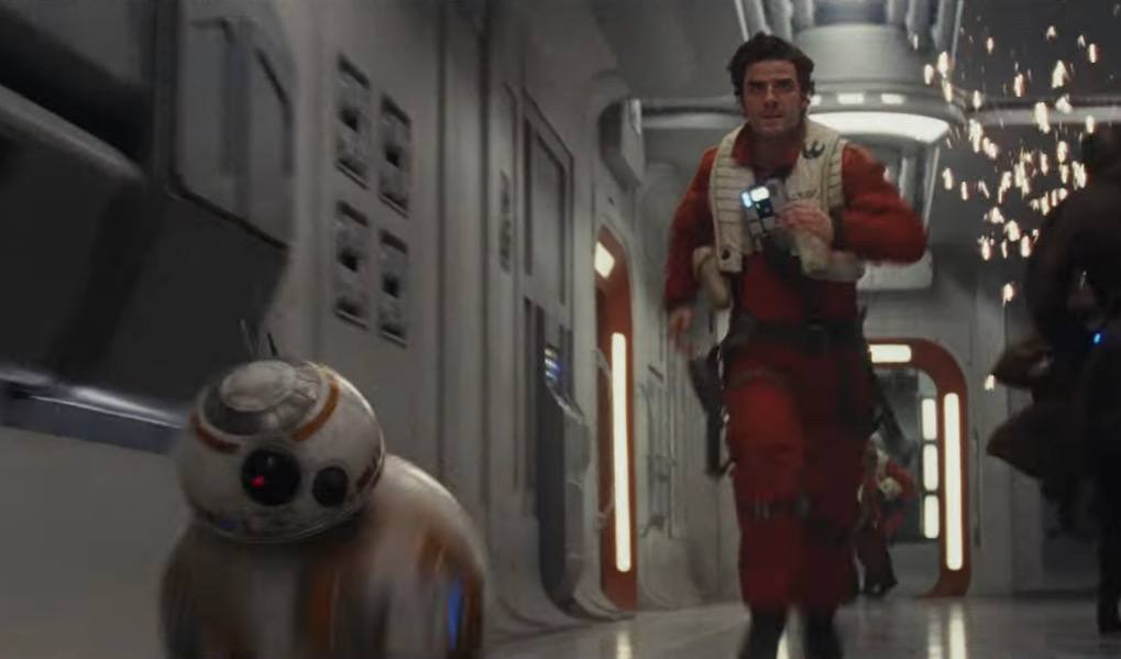 Poe Dameron and BB-8 running through a hallway