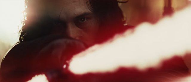 Kylo Ren pointing his red lightsaber.