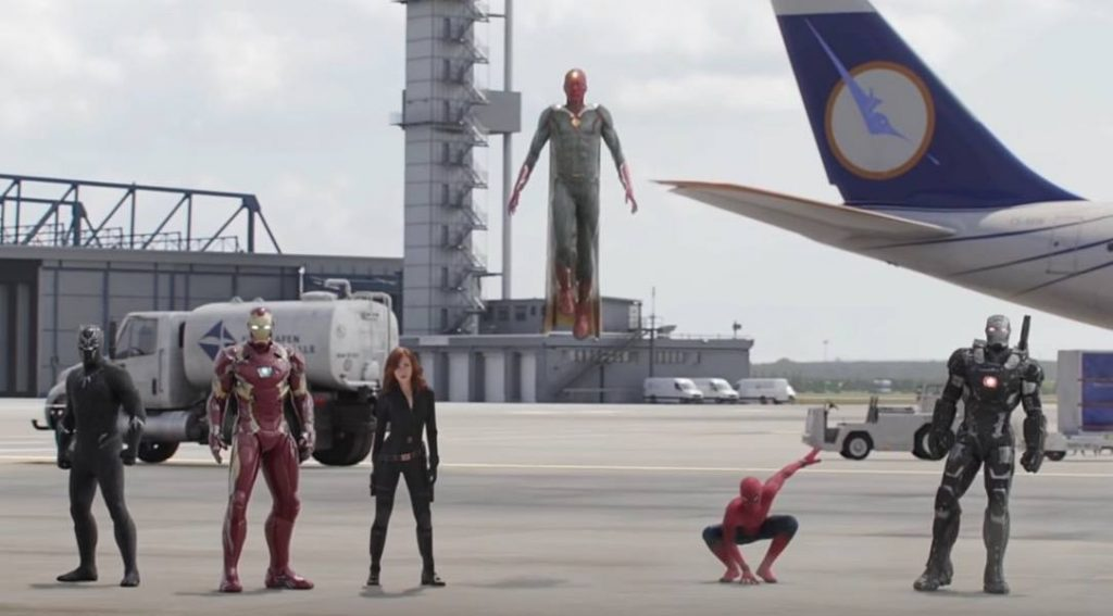 Black Panther, Iron Man, Black Widow, a flying Vision, a crouching Spider-Man, and War Machine together at an airport