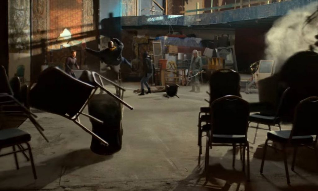 The Defenders in an abandoned theater, getting thrown back by an unseen force