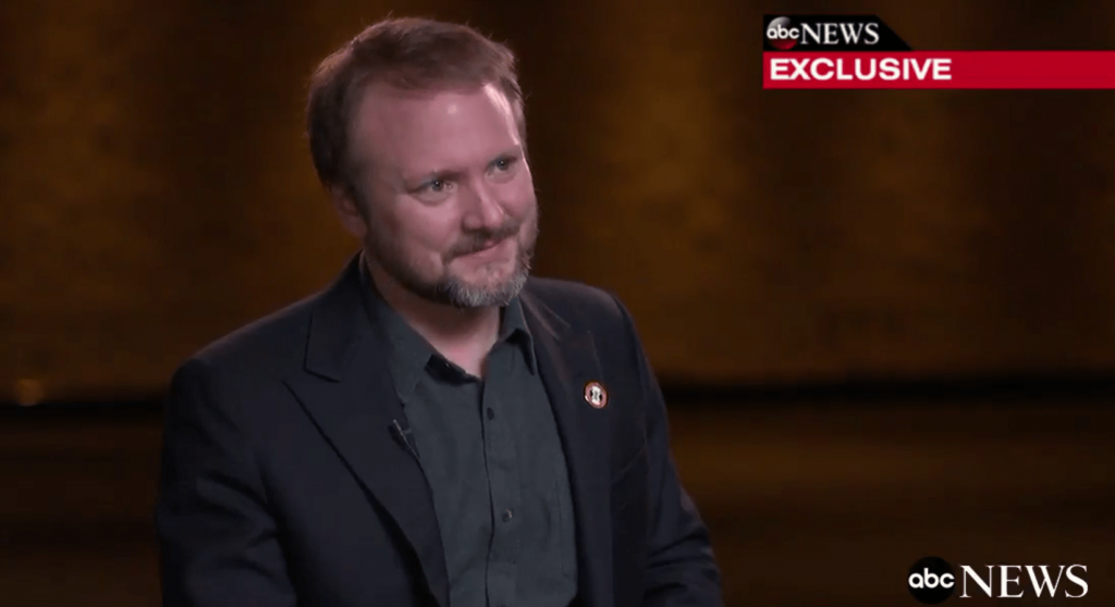 Rian Johnson in an interview with Good Morning America, smiling and looking to the right of the frame