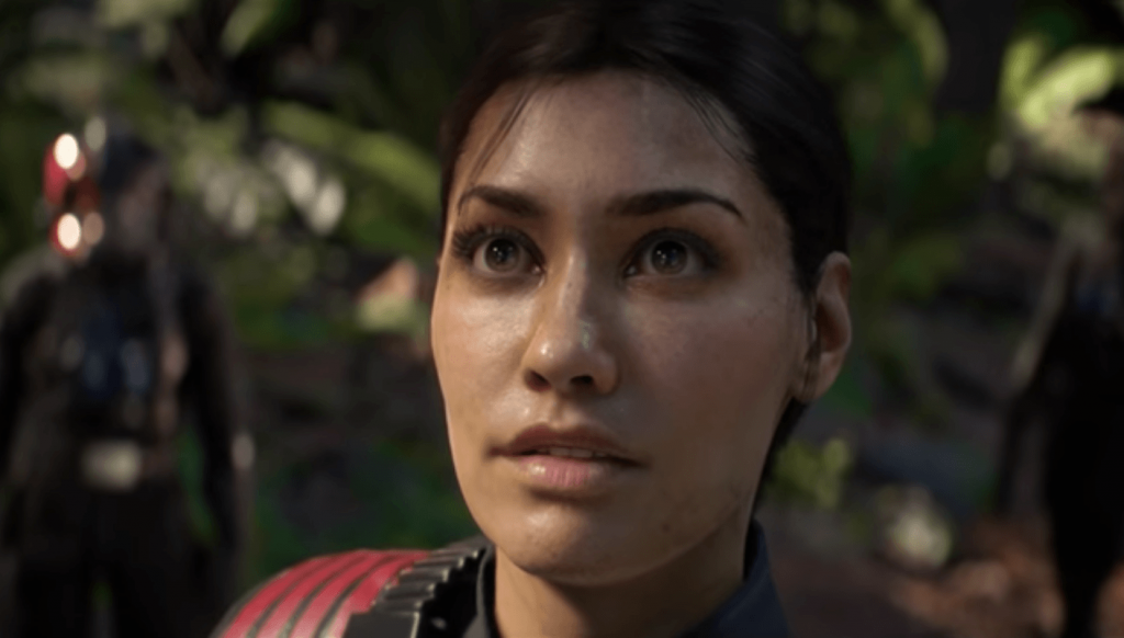A close-up of Iden Versio, glancing upwards in the frame