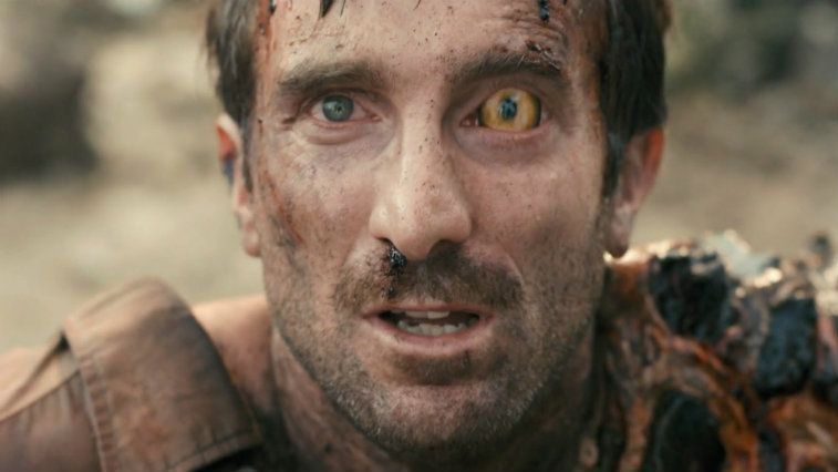 Sharlto Copley with one crazy alien yellow eye in District 9