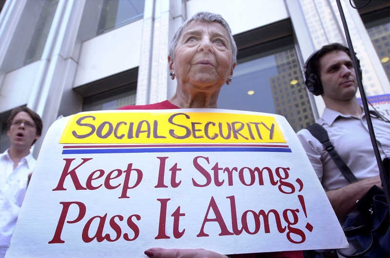 A protester holds a sign supporting social security