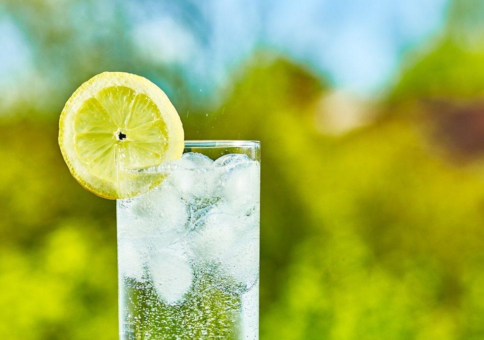 water and lemon slice on glass
