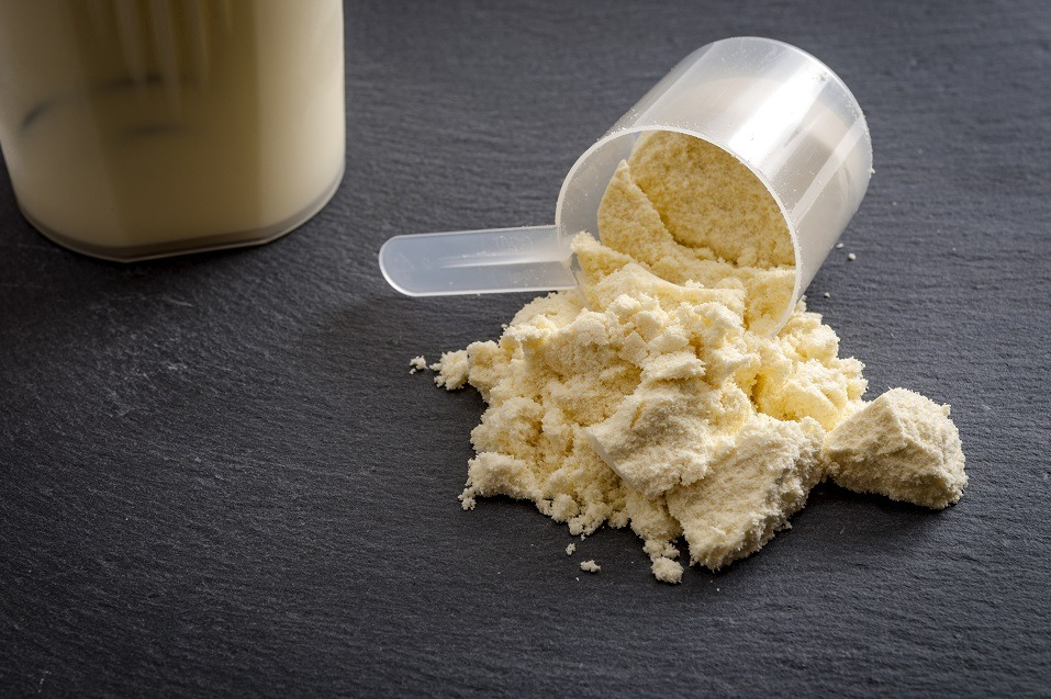 A spilled scoop of protein powder