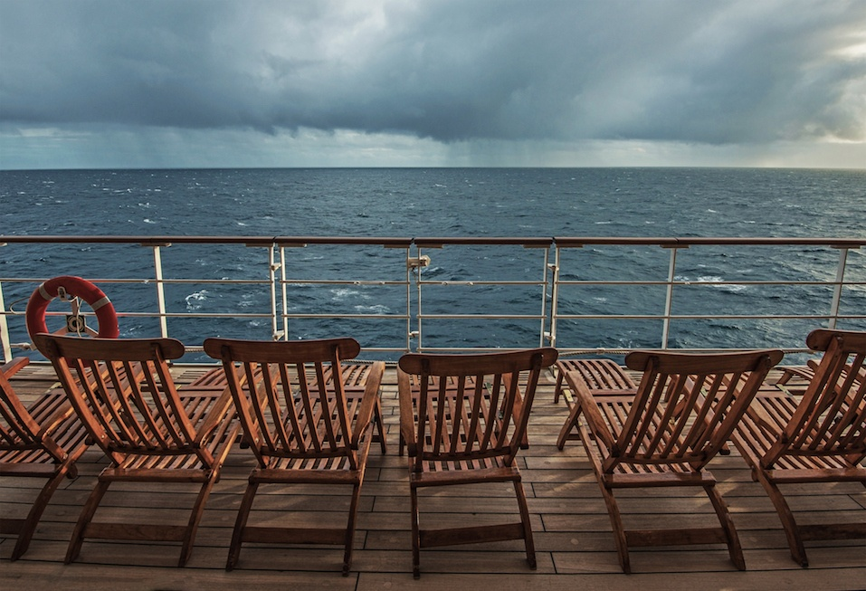 ship deck overlooking storm clouds