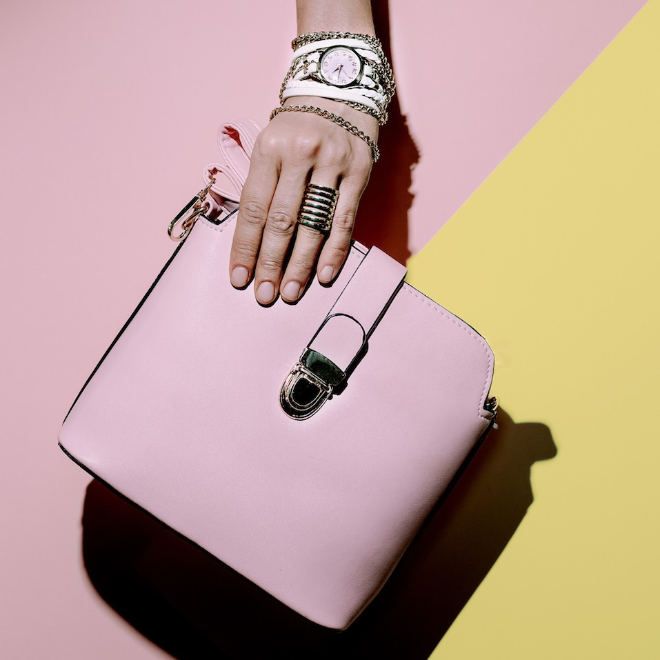Stylish accessories. Bag and jewelery. Pastel colors trend.