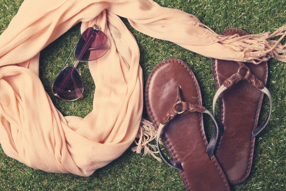 Spring or summer womens fashion accessories lying on grass