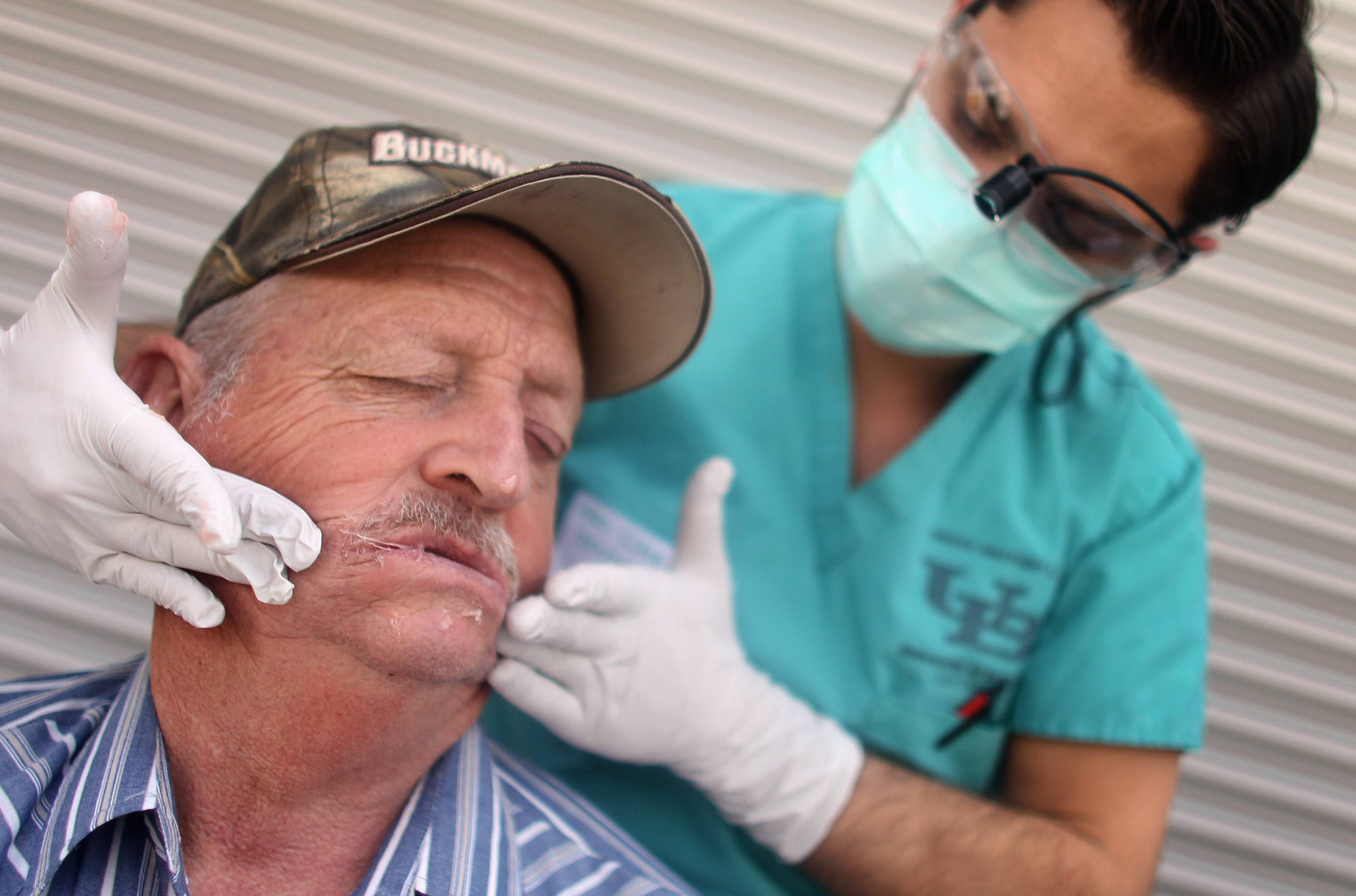 A patient receives dental care at a Tennessee clinic