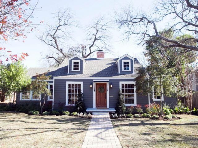 The Exterior Of This Home Features Added Dormers A New Front Door Brick Walkway