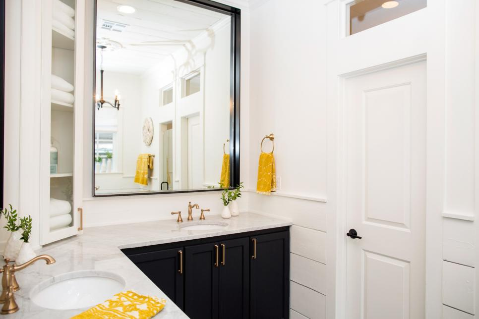 This master bath features a simple color palette with a touch of yellow for a colorful pop, as seen on Fixer Upper.