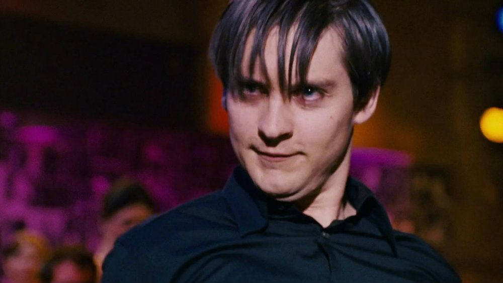 Tobey Maguire in a black shirt making a weird face in 'Spider-Man 3'