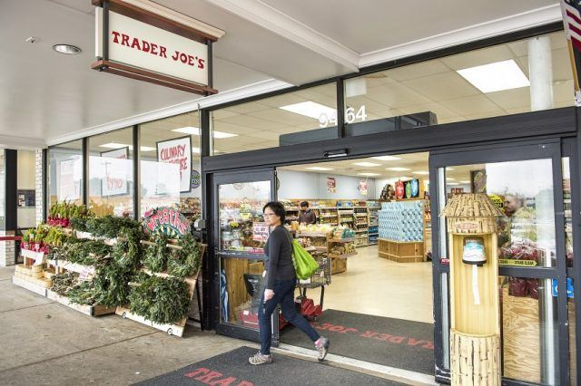 Trader Joes grocery store entrance with sign.