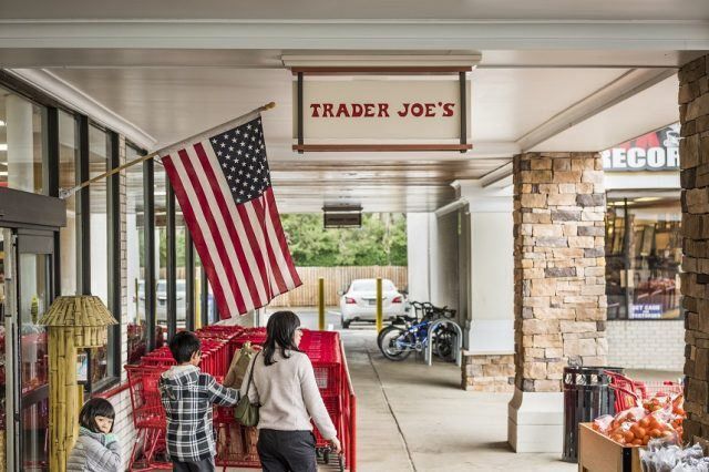 Trader Joes grocery store entrance with sign