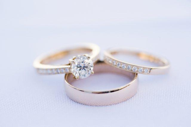 Wedding rings and bands on a white linen cloth.