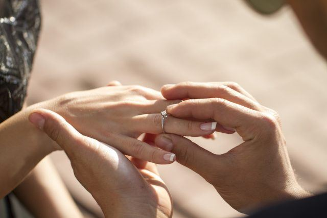 A man proposes to his girlfriend.