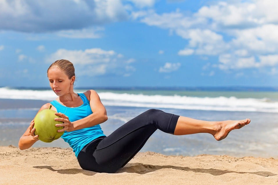 Fit woman exercising stomach muscle