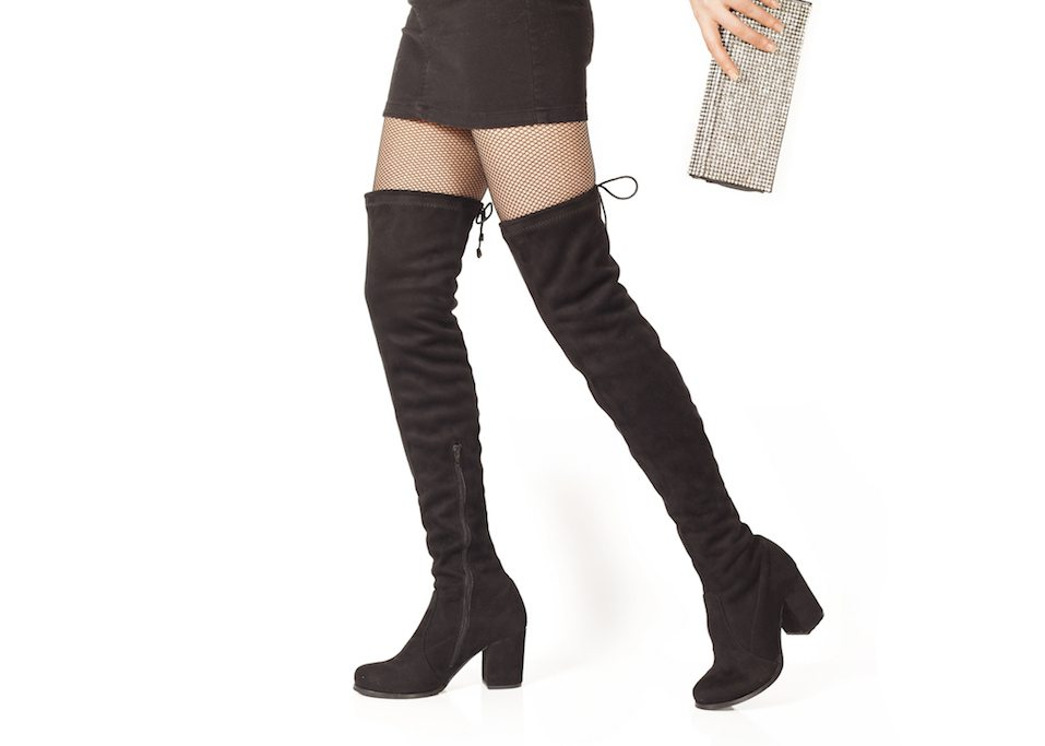Woman legs in black suede boots