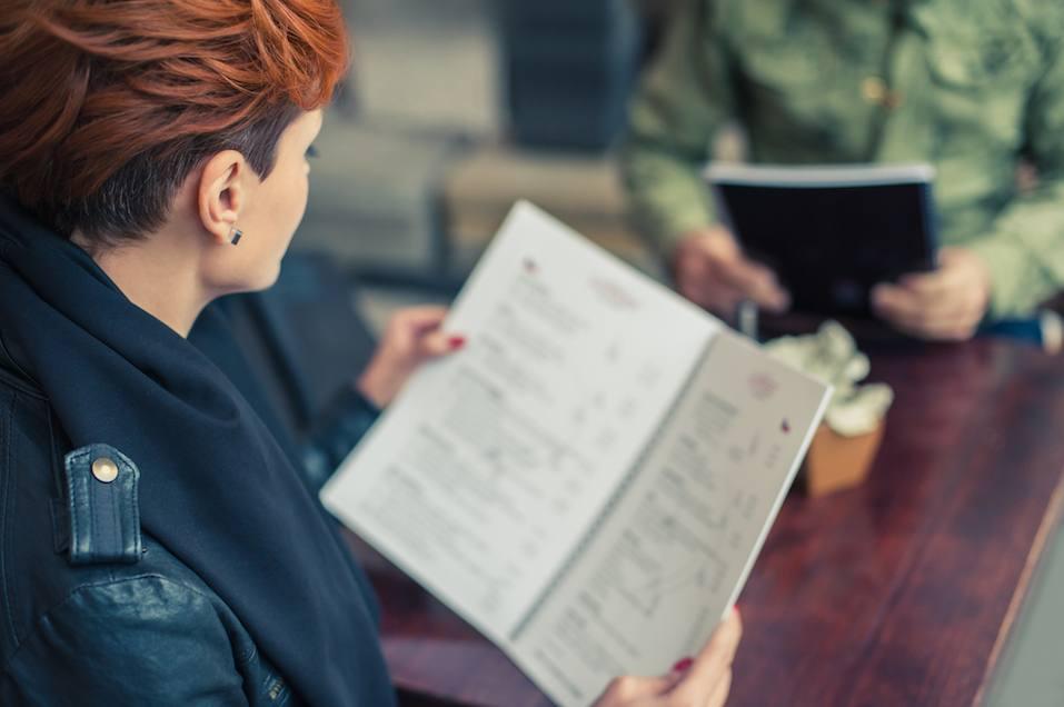 Woman looking at the menu