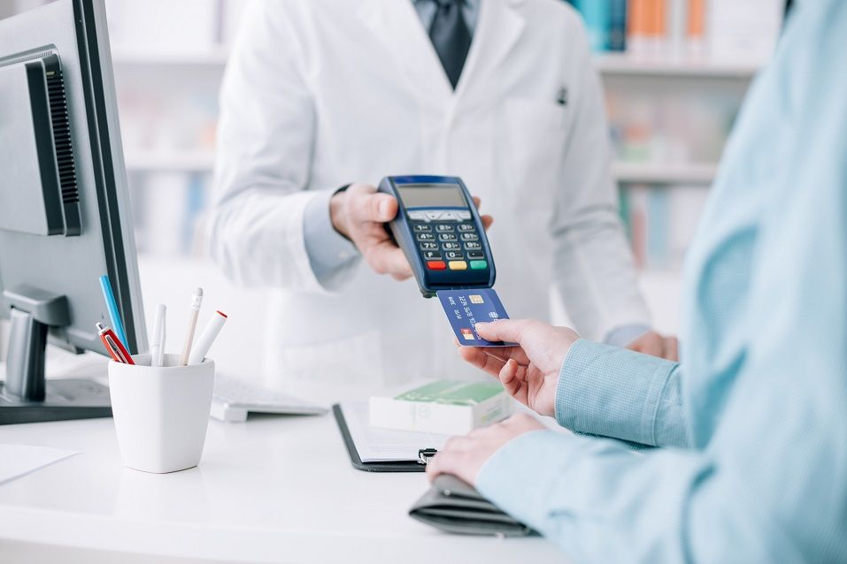 Woman at the pharmacy purchasing medicines