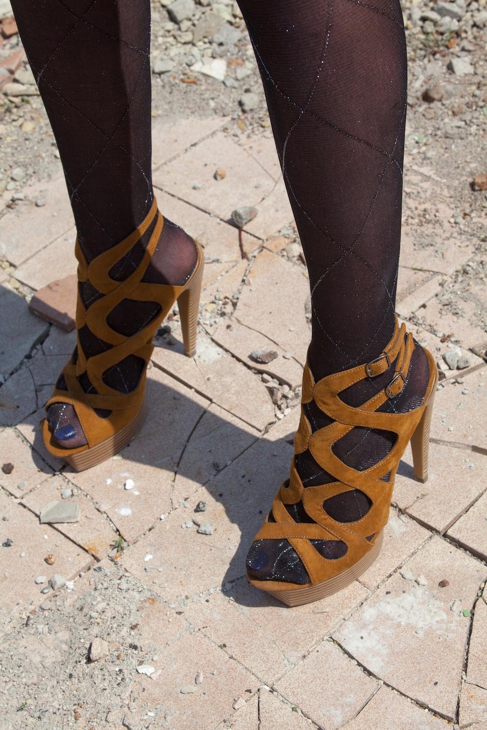 Woman's feet in high heel sandals