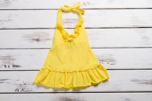 A yellow dress against a wood background