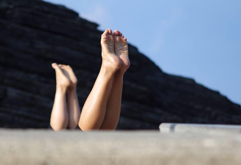 Feet extend upwards