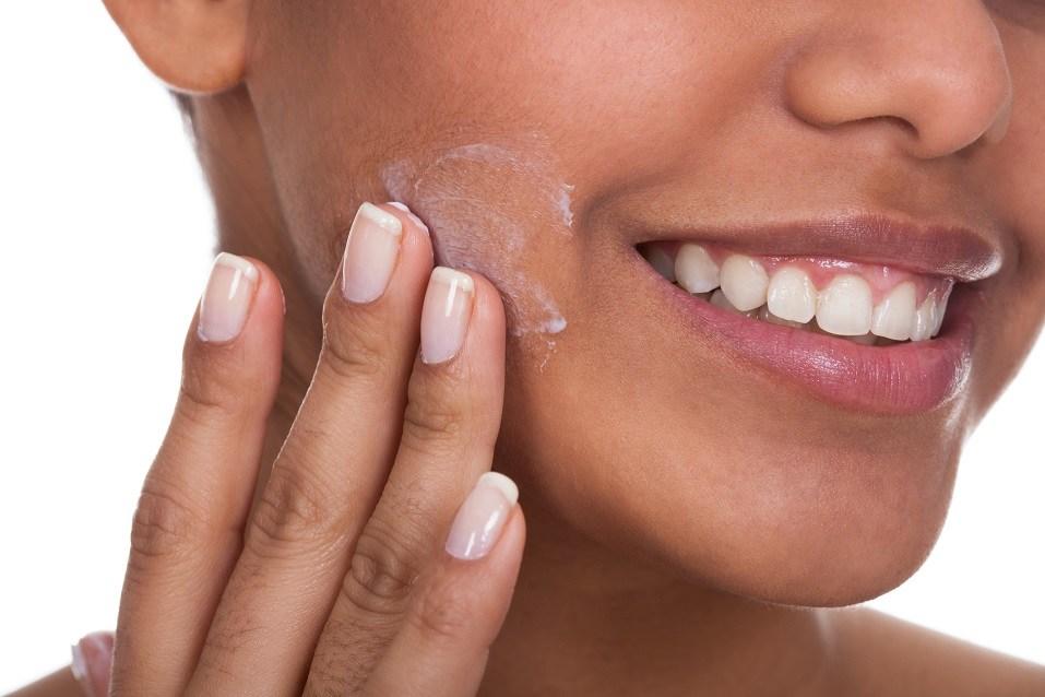 Woman Applying Cream