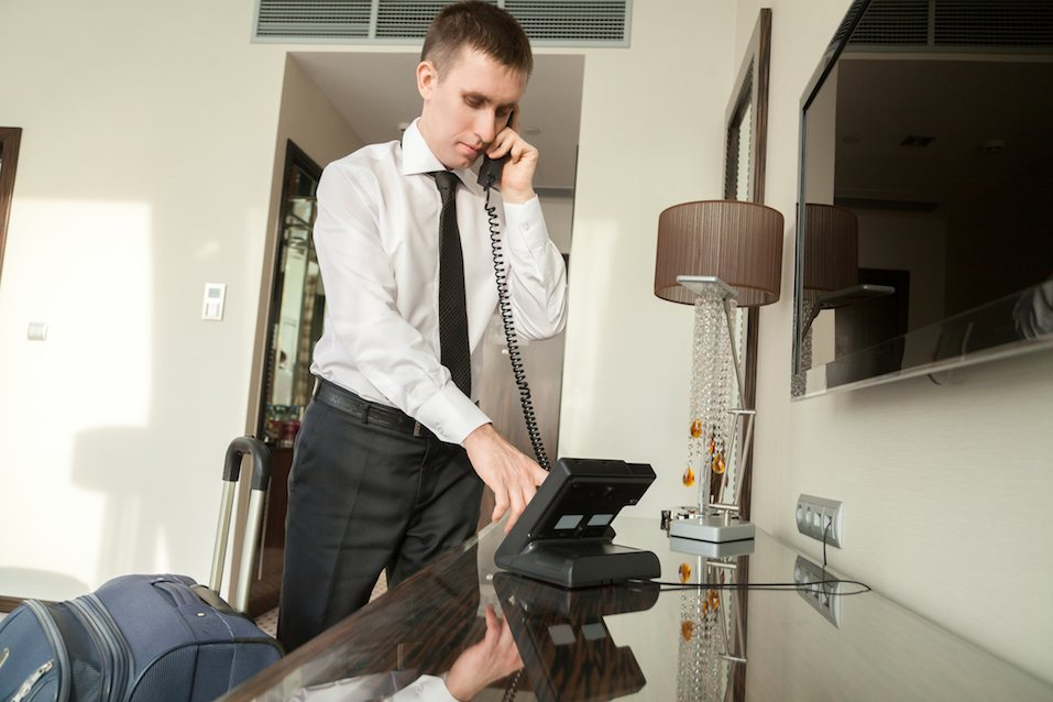 Young traveler businessman wearing white shirt and necktie making call