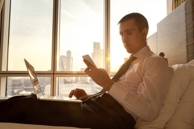 Self-employed person looking at smartphone, messaging