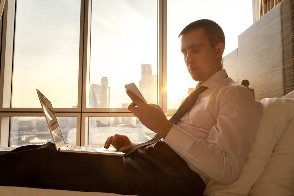 man in 30s looking at phone