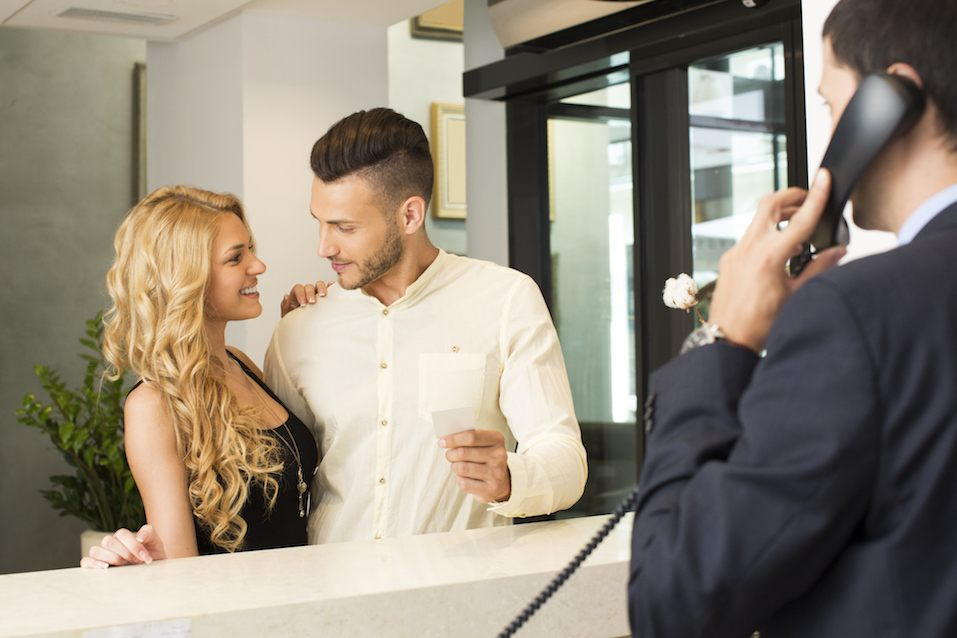 Young couple at a hotel front desk