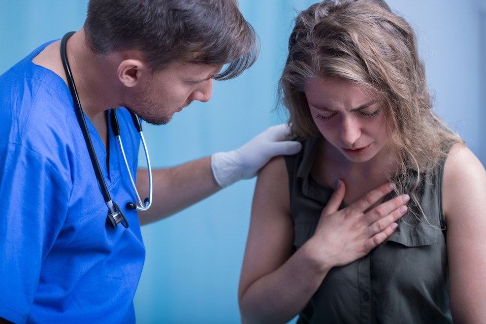 Girl has problems breathing and a doctor helps