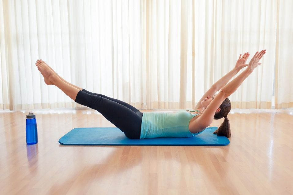 woman exercising and doing sit ups