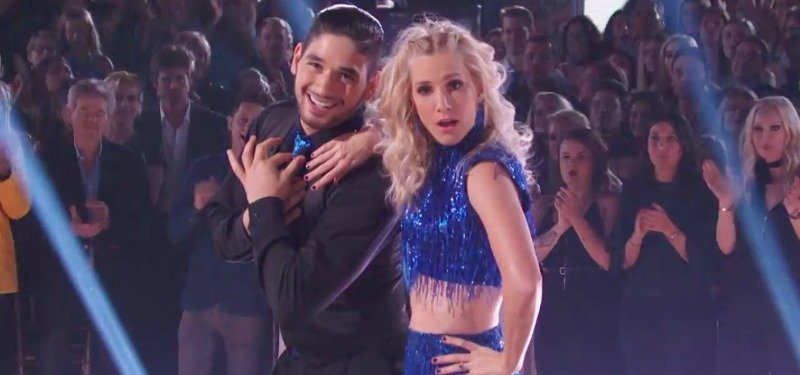 Ala Bersten has both hands over his heart as Heather Morris leans on him while dancing on the show.