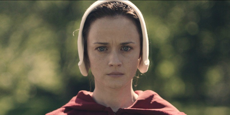 Ofglen looks straight ahead seriously in The Handmaid's Tale.