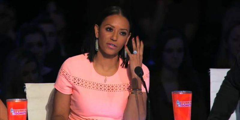 Mel B is a pink dress and talking on the judge panel.