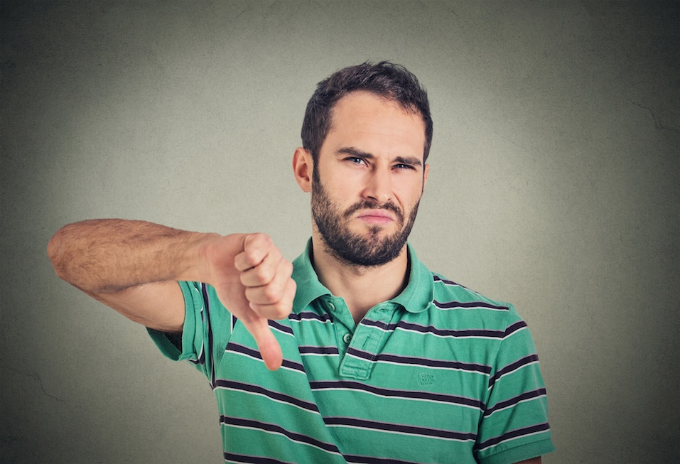 man making a thumbs-down gesture