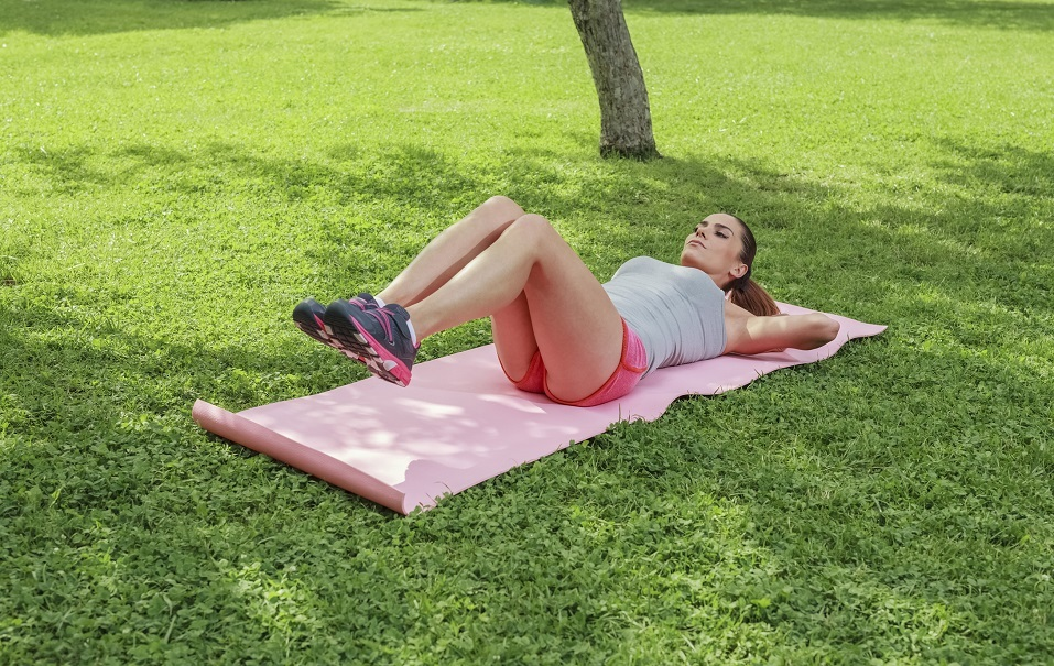 Woman lying on pilates mat