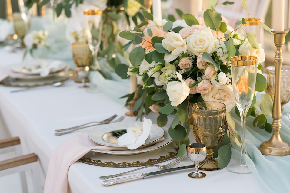 beautifully decorated table with flowers for wedding party