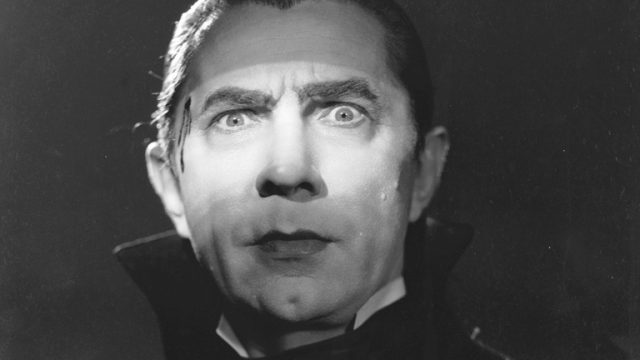 A close-up on Bela Lugosi'a face in Dracula