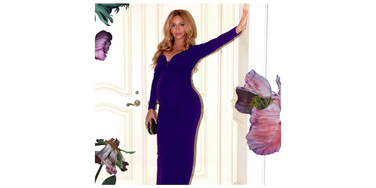 Beyoncé poses in a long-sleeved purple gown.