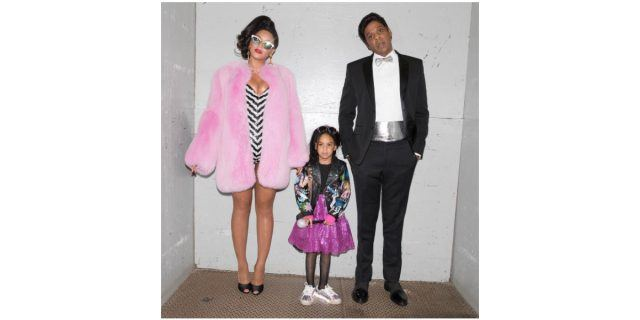 Beyoncé, Blue Ivy, and JAY-Z pose for a photo, dressed in their Barbie Halloween costumes.
